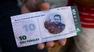 En un barrio venezolano crean moneda con imagen de Chávez | 180